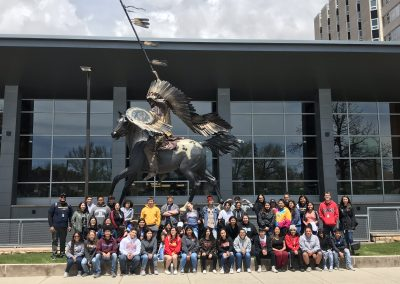 Michael poses for a group picture with his classmates at the University of Wyoming.