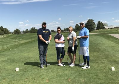 Eric poses with his fellow golfers before participating in our Golf Tournament