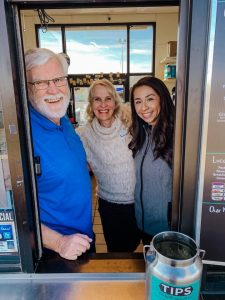 Dr. Reinsvold stands beside former Board Member Molly McIntosh and Dream Team staff member Miranda Ochoa at the Human Bean for a fundraiser in early 2020