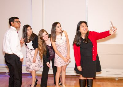 Yessica takes a selfie with her fellow scholarship recipients and her Advisor. They are all smiling.