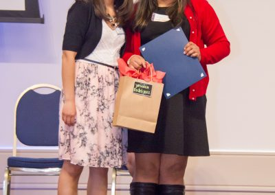 Yessica and her Advisor Moriah pose for a picture as she receives her scholarship.